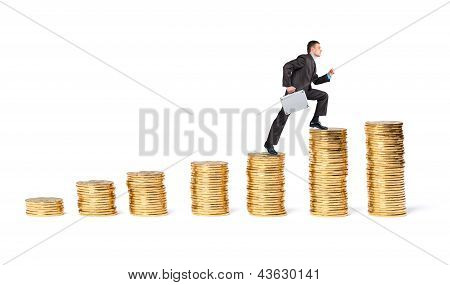 Businessman Goes Up The Gold Coins