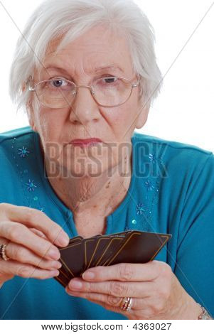 Senior Woman Holding Playing Cards