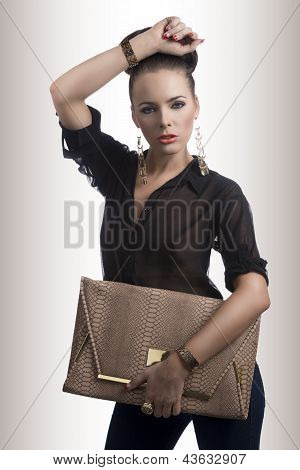 Fashion Brunette With Bag And Hand On The Head