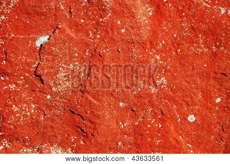 Red Background Of The Mossy Stone Surface