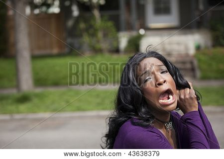Horrified Young African American Woman In Purple Top