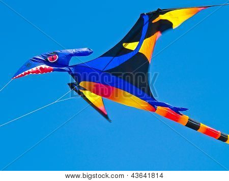 Colorful Pterodactyl Kite Flying In A Bright Blue Sky At The Long Beach Kite Festival