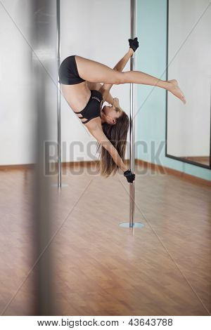 Beautiful woman pole dancing
