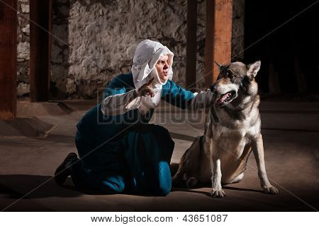 Nun Commanding Dog