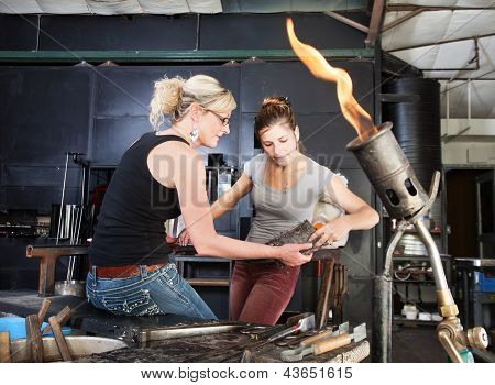 Workers Cleaning Hot Tools