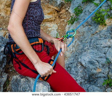 Woman Belays Climber In Mountain Closeup