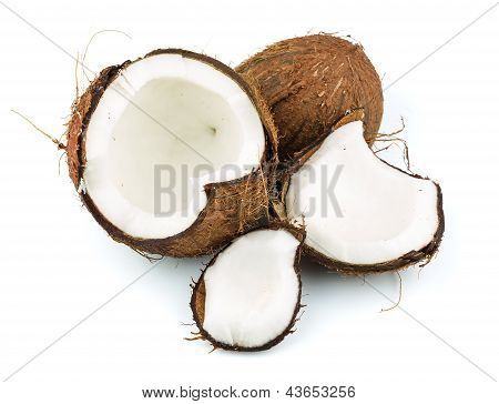 Coconut with coconut candy and green leaf isolated on white background