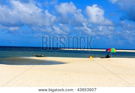 Clouds and white sand beach