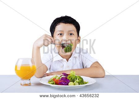 Boy Eating Broccoli - Isolated