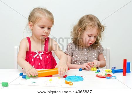 Two Little Girls Sculpting Using Plasticine