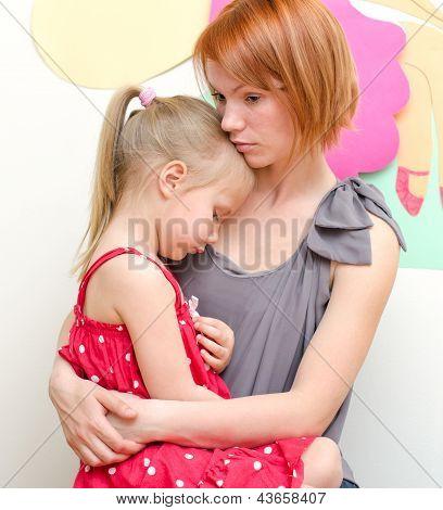 Mother Hugging Her Sad Child