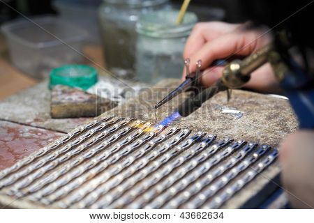 Hands Of Jeweller At Work Silver Soldering