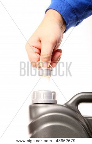 Hand Opening Can With Car Engine Oil Isolated
