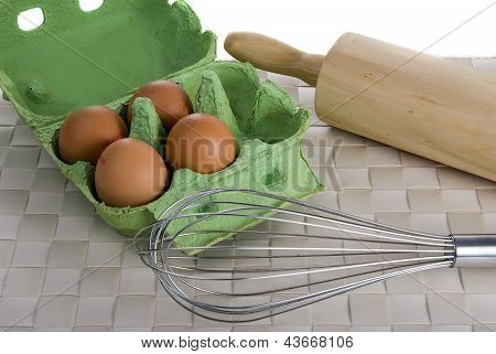 Eggs Ballon Whisk And Rolling Pin On Place Mat