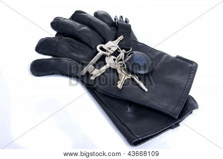 Keys On Black Leather Gloves Isolated