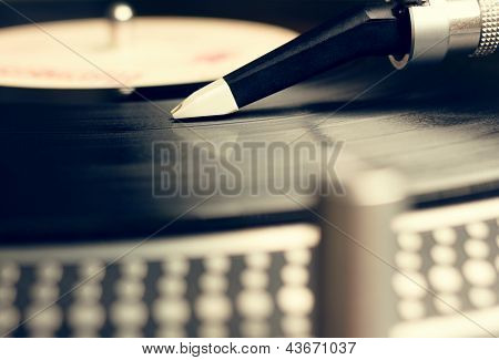 Old Fashioned Turntable Playing A Track From Black Vinyl
