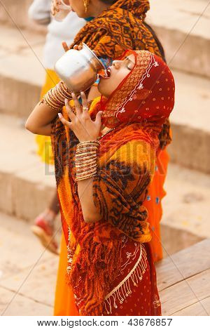 Indian Hindu Woman Drinking Ganges River Water