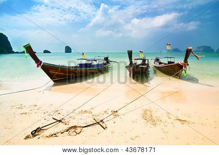 Tropical Beach Landscape. Traditional Long Tail Boats At Ocean. Thailand