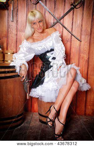 Attractive Girl In A Pirate Costume In A Tavern