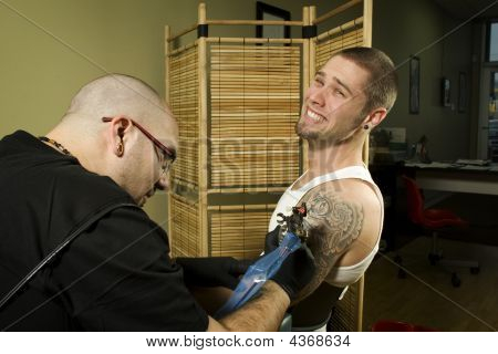 Client In Pain Getting A Tattoo