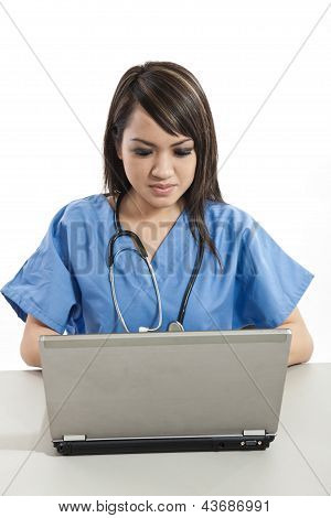 Pretty Attractive Asian Filipino Nurse Working On Laptop