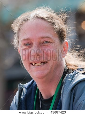 Homeless Woman Smiling With Bad Teeth