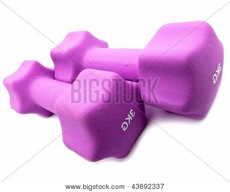 Skipping rope, measuring tape and and Pink dumbbells in a neoprene cover