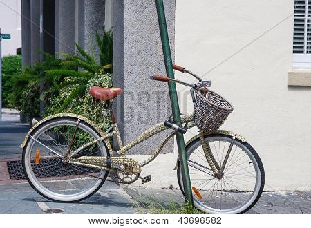 Old Bike With Basket Locked To Pole