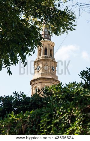 Church Steeple Between Hedge And Trees