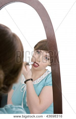 The Young Girl Makes Up Lips