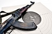 stock photo of ak-47  - kalashnikov ak 74 on a paper target - JPG