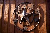 foto of texas star  - An image of a rustic Texas star hanging - JPG