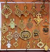 foto of hamsa  - Intricate ornate handmade metal door knockers at a moroccan souk in Marrakech - JPG