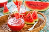 stock photo of watermelon  - Watermelon juice with some pieces of watermelon - JPG