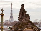 Statue, Column And Eiffel Tower In Paris