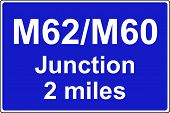 stock photo of m60  - Juction ahead is with another motorway sign - JPG