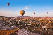 stock photo of valley fire  - Hot air balloon flying over rock landscape at Cappadocia Turkey