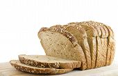picture of whole-grain  - Sliced loaf of whole wheat bread isolated on white - JPG