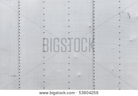 Abstract Background Photo Texture Of Gray Metal Wall With Rivets