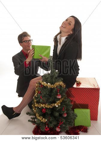 Two Beautiful Young Business Couple With Gifts