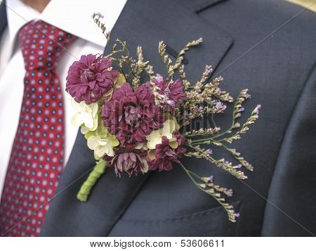 Flower Corsage On A Man's Suit