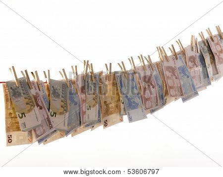Many Euro Banknotes On A Clothesline