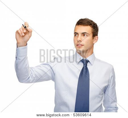 business and office concept - attractive buisnessman or teacher with marker writing or drawing something