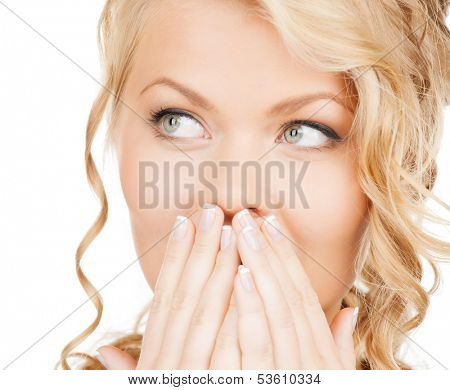 health, beauty, business concept - face of beautiful woman covering her mouth