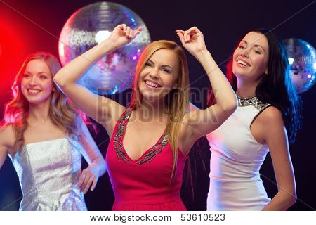 "party, ""new year"", celebration, friends, bachelorette party, birthday concept - three beautiful women in evening dresses dancing in the club"