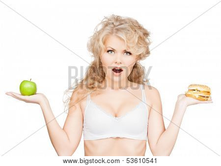 health, beauty, weightloss, food, diet concept - sporty woman with apple and hamburger