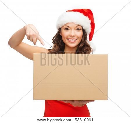 christmas, x-mas, winter, happiness concept - smiling woman in santa helper hat with parcel box