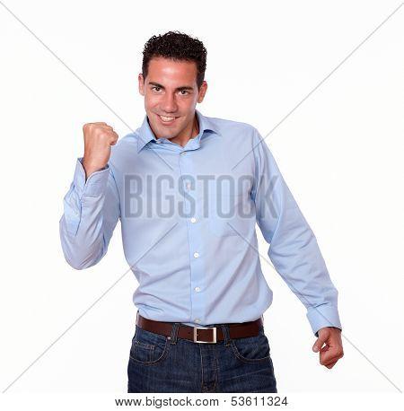 Charismatic Hispanic Man Celebrating His Victory