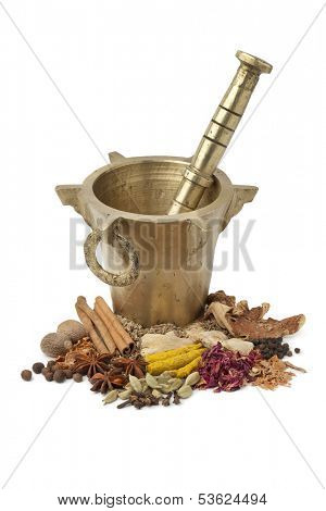 Moroccan Mortar, pestle and dried herbs for Ras el Hanout on white background