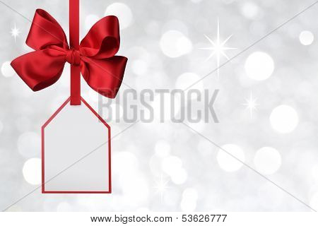 Bow with tag on abstract background
